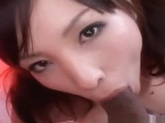 Cute Asian gal is chewing on his tube steak and eating the cream