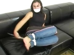 Girl gagged and bound hogtied on a couch