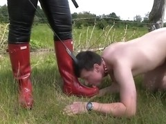 Mistress walks with her Slave on a Leash