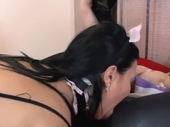 Lesbians having a passionate makeout session in leather leggings