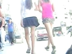 Two  cuties stalked around by an upskirt voyeur