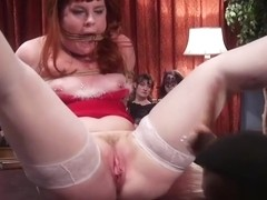 Three female slaves sucking one cock
