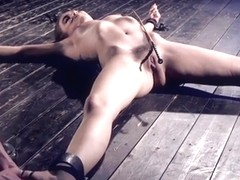 Brunette gets feet tormented in bondage