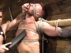 Inked sub gets cock toyed and throatfucked