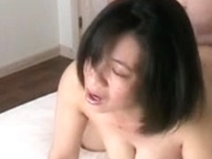 Asian wife enjoying her husband's cock from behind