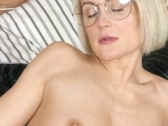 Great looking blonde with glasses, Nata took off her red dress and started rubbing her shaved pussy