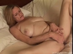Aged trailer trash dilettante with large boobs plays with her
