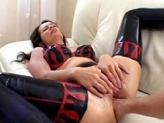 Chick in latex double fisted
