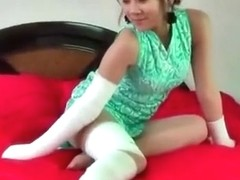 Chinese girl with bandage all over her injured body, wearing nylon