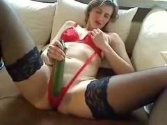 Horny pierced MILF with cucumbers in both holes