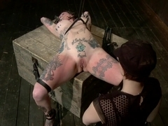 Kathryn Dupri Submits to Leather Restraint