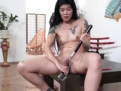 Hot geisha peeing and dildoing herself