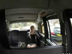 Slim British blonde fucks huge cock in fake taxi